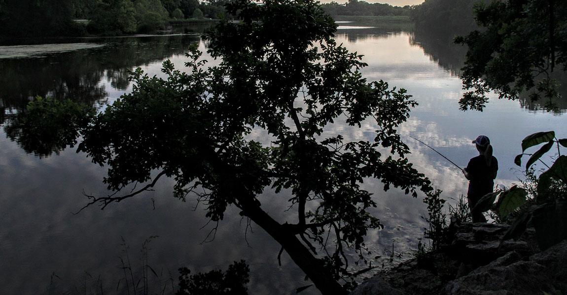 Woman Fishing at Lake photo